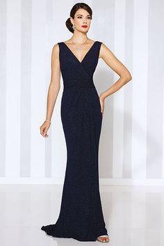 Sleeveless sheath with front and back V-necklines, pleated natural waistband, and center gathered skirt. Matching shawl included.Available Colors: Navy Blue, BlackEnter to win dresses for mom, a David Tutera consult and more ►
