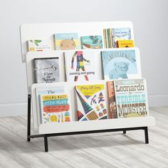 Shop New Issue Modern Bookcase (White/Black Base).  Our New Issue Modern Bookcase (White/Black Base) featuring a three-tier design that allows the books to display forward facing.  Shop bookcases today.