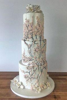 42 Eye-Catching Unique Wedding Cakes � unique wedding cakes tall white with branches and pink mother of pearl charm city cakes via instagram #weddingforward #wedding #bride #bridalcake #uniqueweddingcakes