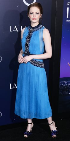 For the premiere of La La Land, Emma Stone mastered a monochromatic colour palette with shades of blue in a jewel-encrusted cerulean blue Prada number, complete with feathery sequined cobalt blue Jimmy Choo sandals, Monique Péan jewelry and metallic blue-rimmed eyes.