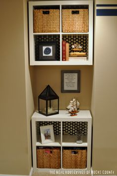 This was featured on the Nate Berkus show yesterday... BRILLIANT!  It's two sets of shelves.  The one on top was nailed to the wall and the back side was covered with wrapping paper- great idea!