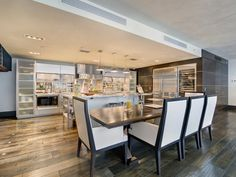 Modern kitchen and dinning table at South Pointe Modern Apartment, Miami Beach, Florida