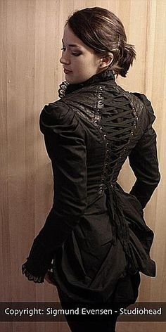 The detailing on this jacket is incredible. jls Yet a women with a corset and a tail coat is fit to wed or take to bed. hehehe she has to have a bottom.