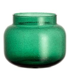 Dark green. Small glass vase with visible air bubbles. Diameter at top 4 3/4 in., height 5 3/4 in.
