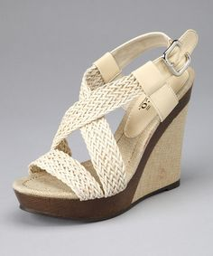 Nothing adds a splash of spring style to steps quite like a pair of wedge sandals. This pretty pair gives outfits a boost and makes serious height a reality. These wonderful wedges are the definition of casually chic fashion.4.5'' heel with 1'' platformBuckle closureMan-madeImported