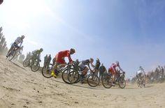 The peloton speed past in the 2013 Paris-Roubaix