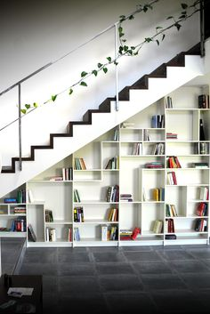 UNDER STAIRS BOOKSHELVES: Materials: Five white Billy Bookcases. All modules are of the regular Billy with the exception of the second one to the left cut to end where the floor step is.