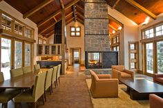 Living and dining area in a Colorado mountain home... Spectacular! #wood #stone #windows #lodge #luxury #house