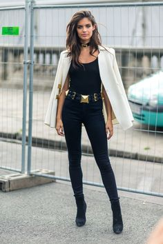 How to wear ankle boots: 40 outfit ideas to try this season. Sara Sampaio wears black ankle boots with jeans and a white blazer.