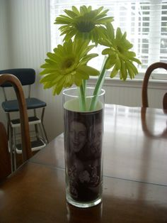 LOVE this idea for graduation centerpieces.  And I'm a HUGE gerb daisy fan.
