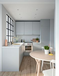 Small kitchen, but it looks quite functional and stylish. That soft powder grey/blue is lovely. // VWArtclub - Small & Cozy Apartment