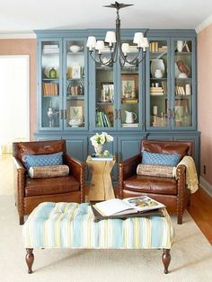 Hutch in dining room. Not blue. Glass front. Mix china and silver and books and pictures. Love it!