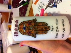 candle with Hamsa design