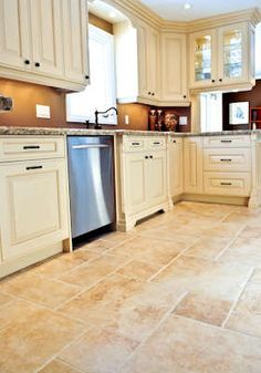 Kitchen colors- tile floors, antique white cabinets with dark pulls/faucet and fixtures