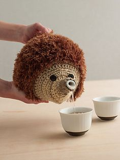 Hedgehog tea cosy. Too Cute! (A crochet pattern that I could never accomplish...)