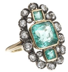 Beautiful and antique-y diamond jewelry featuring emerald and old cut white diamonds. This ring should be the best accessory to wear with a simple vintage dress or a cocktail dress that doesn't have all the trimmings