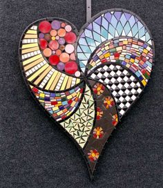 heart mosaic. I'd like to try something like this using pieces of felt and placing beads in between the pieces.