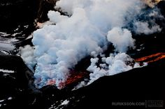 """Aerial images from the volcanic eruption at Fimmvörðuháls in Iceland. Images taken on 4th of April 2010. The volcanic eruption began on the 21st of March 2010, located on the popular hiking route Fimmvörðuháls, east of Eyjafjallajökull glacier. The ongoing eruption has become a large tourist attraction. The molten lava flows from the volcano's vent into nearby gorges, Hvannárgil and Hrunagil, creating a lava-""""waterfall""""."""