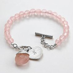 It's hard to choose jewelry for others, as that's so personal! But I think this bracelet is so pretty... perhaps my daughter would like it.  rose quartz heart charm bracelet from RedEnvelope.com