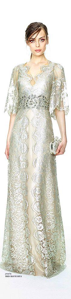 scalloped edges, metallic lace-like overlay, sheer sleeves, and slight empire waist. love