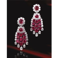 Pair of ruby and diamond pendant-earclips, Van Cleef & Arpels, Paris, circa 1960 | Lot | Sotheby's