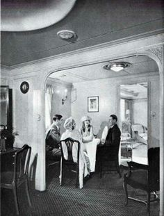 Breakfast Room of one of the Premier suites on the S.S. Leviathan of the United States Lines circa 1923. On this voyage, two couples find this breakfast nook delightful for an informal morning meal.