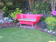 Old metal bathtub cut in half and painted makes a great garden seat. This is so cute!