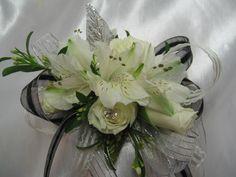 [Image: White corsage]