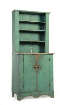 """AMERICAN DIMINUTIVE STEP-BACK CUPBOARD.  Nineteenth century, pine. One piece, the upper section with open shelves, the lower section with two plank doors. Old blue paint. 67""""h. 30'w. 18""""d. Ex Stephen-Douglas (Vermont)."""