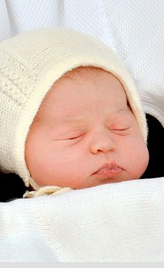 Princess Charlotte Elizabeth Diana of Cambridge sleeps thru the commotion as she is introduced to the world. The Royal Mint revealed last month that it would gift 2,015 silver pennies to the families of babies born on the same day as the new prince or princess. The tokens will be engraved with the year of their birth to celebrate the arrival of the Duke and Duchess of Cambridge's second child.