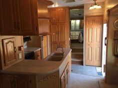 """2006 Used Keystone Montana 3400RL Fifth Wheel in California CA.Recreational Vehicle, rv, 2006 Keystone Montana 3400RL, Fifth Wheel, GENERATOR ! 100% Aluminum Framing, Artic Package, Upgraded Living area 40"""" LCD TV and Bedroom 24"""" LCD TV. Wineguard Auto Satelite, Onan 5500LP Generator 180 Hours. Added addl A/C in Bedroom, Power Vent, Custom Pantry in Kitchen Area, Washer/Dryer Hookups, Upgraded Mattress, Awning, Set up for Toy Tote (Also Available), Lots of Storage! Tires purchased in 2015…"""