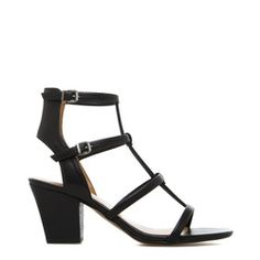 Love the chunky heel and ankle strap on these!