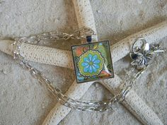 Silver Plated Turquoise Blue Daisy Paisley Glass by SILJEWEL, $15.00
