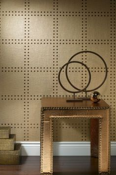 Phillip Jeffries wallpaper makes walls look like they are studded with nailheads