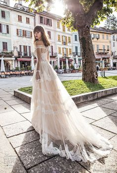 This gorgeous wedding dress from the Pinella Passaro 2018 bridal collection is an off the shoulder cut with stunning long poet sleeves.