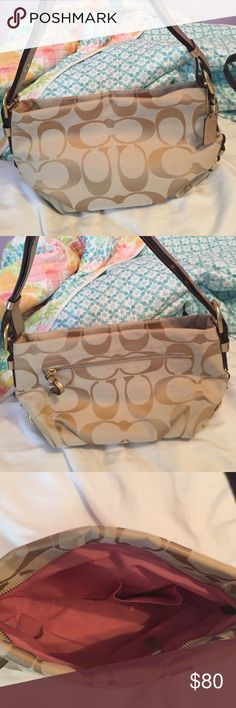 Gold coach purse NWOT gold shimmer coach purse. Beautiful purse that is in perfect condition. All the leather has a gold shimmery tone to it. The purse has one outside pocket and multiple ones inside that are great for organizing your purse! Coach Bags Shoulder Bags
