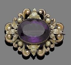 Mid c Amethyst Brooch centrally set w a collet-set oval-cut amethyst within a repoussé scrolling surround Victorian Jewelry, Antique Jewelry, Vintage Jewelry, Purple Jewelry, Amethyst Jewelry, Art Nouveau Jewelry, Jewelry Art, Antique Brooches, Handmade Jewelry Designs