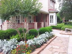 Seasonal perennial color with flagstone pathway and edging.