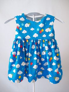 The product Age 1 - Clouds & Balloons Print Lemonade Party Dress is sold by Smile & Make in our Tictail store.  Tictail lets you create a beautiful online store for free - tictail.com
