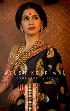 Classy black, gold, and red sari. Perfect look for a mother of the groom or mother of the bride.
