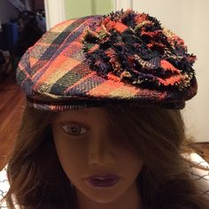 Sale tonight Plaid Wool Cap Adorable wool cap in plaid with a flower made of the same fabric on the side of cap. It's not marked in size but would fit a medium.  Wish I didn't have to give it up but it's too tight on me. From City Hats. Worn only once. Accessories Hats