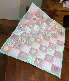 A personal favourite from my Etsy shop https://www.etsy.com/uk/listing/484449275/laura-ashley-mint-pink-baby-quilt-baby