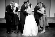 With their happily married parents,love this pic. Though I'm not sure I could get my in-laws to kiss.