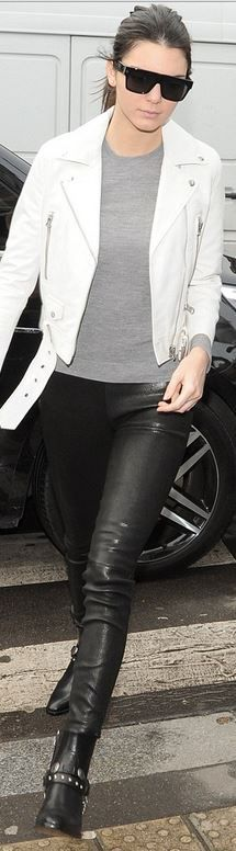 Kendall Jenner's black studded boots, sunglasses, leather skinny pants, and white belted jacket stret style id