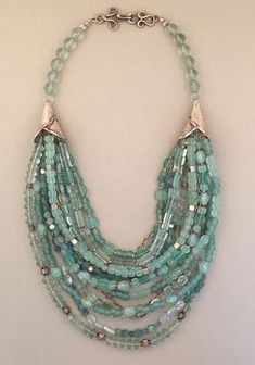 "Beads: Blue Fluorite, Vintage Glass, Sterling Silver Dimensions: 27"" This is a heavier piece."