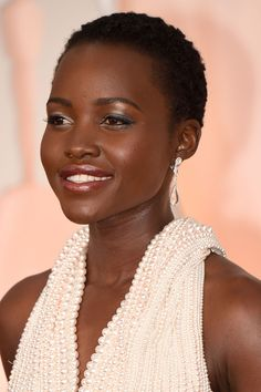 Lupita Nyong'oEveryone might have been buzzing about the dress Lupita Nyong'o wore, but we couldn't tear our eyes away from her metallic lip. Rather than balance the pearlescence of her, well, pearl dress, makeup artist Nick Barose decided to amp it up with a metallic, smoky eye and an equally dazzling aubergine foiled lip, ...