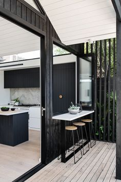 The distinct roofline of Pleated House not only pays homage to midcentury architecture, but also makes room for clerestory windows that flood the interiors with light. Black Cladding, Timber Cladding, External Cladding, Architecture Design, Indoor Outdoor Kitchen, Outdoor Living, Outdoor Kitchens, Outdoor Rooms, Weatherboard House
