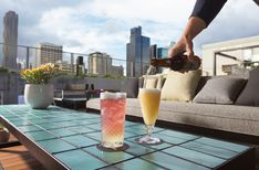 Offering warm weather cocktails with a side of skyline.