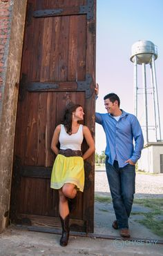 Engagement photos and ideas for tall wooden door at the Cotton Mill in McKinney, TX
