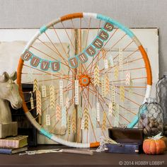 Transform an old bike wheel with spray paint, yarn, and custom-made tags. You can write or stamp things you are thankful for on  the tags, or leave them blank for others to add their own blessings!